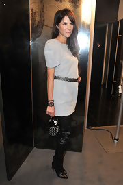 Caroline Sieber turned heads at the Chanel Haute Couture show in black snakeskin Lili thigh high boots.