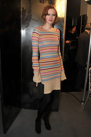 Karen donned a colorful striped sweater dress to the Chanel show in Paris.