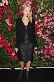 Naomi Watts arrived at the Chanel artist dinner wearing a shiny gunmetal gray pair of zippered ankle boots.