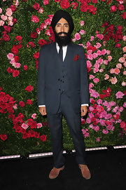 Waris Ahluwalia looked incredibly dapper at the Chanel dinner in this three-piece pinstripe suit with a red pocket square.