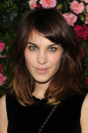 Alexa Chung wore her hair in tousled layers with long side-swept bangs at the Chanel artist dinner at the Tribeca Film Festival.