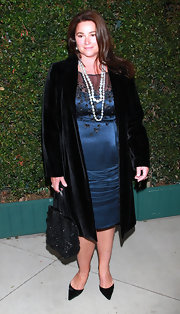 Keely Shaye Smith layered a black velvet evening coat over an equally chic dress for a totally elegant look.