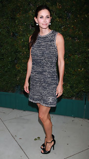 Courteney Cox looked classic and sophisticated in a sleeveless day dress.