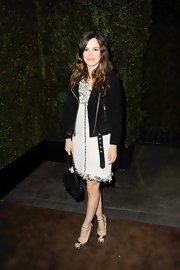 Rachel Bilson gave her ladylike tweed dress a youthful edge with a black biker jacket.