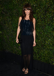 Helena Christensen donned a sheer black evening dress with a sparkly underlay for the Chanel and Charles Finch pre-Oscar dinner.