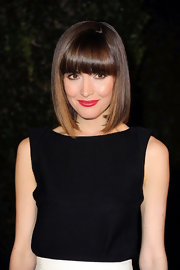 Rose Byrne wore a striking shade of red lipstick at the Chanel and Charles Finch pre-Oscar Dinner.