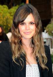Rachel Bilson kept her hair fairly simple for the Chanel show. Side swept bangs and straight tresses completed her hairstyle.
