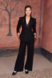 Liu Wen opted for a black wide-leg pantsuit by Chanel when she attended the label's Cruise photocall.