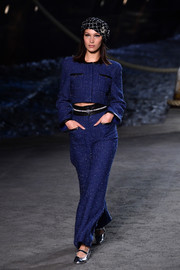Bella Hadid was classic and stylish in this sparkling blue tweed pantsuit while walking the Chanel Cruise runway.