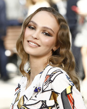 Lily-Rose Depp wore her hair down in a wavy style at the Chanel Cruise 2020 show.