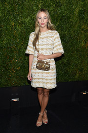 Harley Viera-Newton opted for a gold and white tweed dress when she attended the Tribeca Film Festival Chanel dinner.