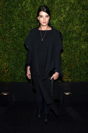 Crystal Renn attended the Tribeca Film Festival Chanel dinner looking goth in a black coat and skinny pants.