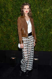 Lindsey Wixson contrasted her tough-looking jacket with flirty sheer floral pants.