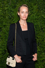 Amber Valetta attended the Chanel dinner for Lucia Pica carrying a quilted Chanel bag with a gold chain strap.
