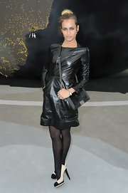 Alice Dellal's LBD had a bit of an edge with its long sleeves, pockets and leather look.