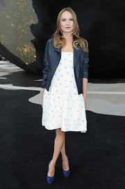 Ana Girardot looked feminine and fun at the Chanel runway show were she sported a dotted day dress.