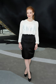 Jessica Chastain paired a ruffled blouse with a black pencil skirt for a classic look at Paris Fashion Week.
