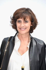 Ines de la Fressange looked darling with her short curls and wispy bangs at the Chanel Couture fashion show.