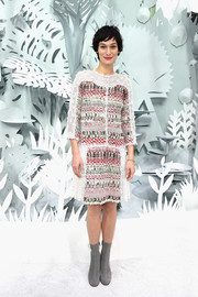 Clotilde Hesme attended the Chanel Couture show wearing a stylish tweed shift dress.