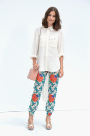 Alma Jodorowsky styled her top with a pair of colorful print pants.