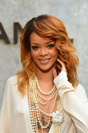 Rihanna's burnt red locks looked simply effortless when styled into wind-swept waves.