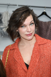 Milla Jovovich topped off her look with a wavy bob when she attended the Chanel Couture show.