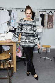 Araya A. Hargate attended the Chanel Couture show wearing a long-sleeve print blouse from the label.