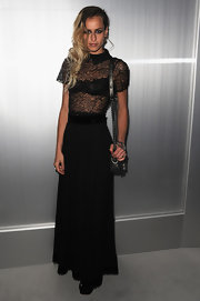 Alice Dellal attended the Chanel Spring 2012 Show in a dramatic ankle-grazing dress by the French label.