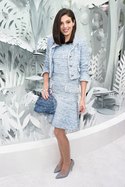 Razane Jammal chose a baby-blue tweed skirt suit by Chanel for the French house's couture show.