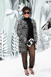 Kris Jenner tempered her sexy pants with a black-and-white tweed coat, also by Chanel.