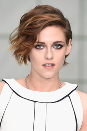 Kristen Stewart went heavy on the eyeshadow for a rocker-glam finish.