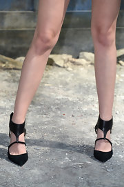 Kristen rocked black strappy sandals with her tuxedo jacket and shorty shorts at the Chanel Front Row at Paris Fashion Week Haute-Couture.