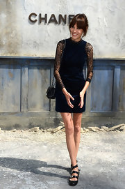 Alexa Chung wore a blue velvet dress with sheer sleeves at the Chanel Haute Couture runway show.