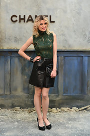 Cecile rocked a black leather mini with her sleeveless green lace top at the Chanel Haute Couture show.