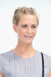 Poppy Delevingne polished off her look with a lovely pair of star-shaped diamond studs.