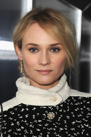 Diane Kruger wore her tresses in a causal updo at the Chanel fashion show in Paris.