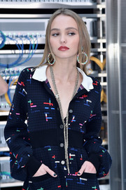 Lily-Rose Depp attended the Chanel Spring 2017 show wearing a chic gold chain necklace from the label.