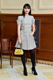 Isabella Manfredi added a jolt of color to her monochrome outfit with a quilted yellow leather bag, also by Chanel.