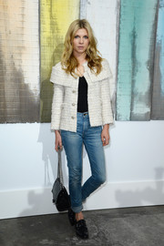 Clemence Poesy glammed up her jeans with an elegant tweed jacket during the Chanel fashion show.