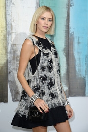 Elena Perminova showed her love for Chanel with this double-C chain-strap bag and mini dress combo during the label's fashion show.