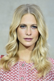 Poppy Delevingne's locks were perfectly curled for at the Chanel Spring/Summer 2015 show.