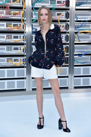 Lily-Rose Depp donned a Chanel print blouse with a contrast collar and a cinched-in waist for the label's Spring 2017 show.
