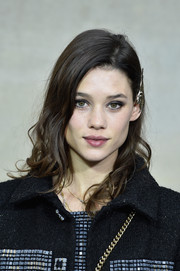 Astrid Berges Frisbey looked sweet wearing this half-pinned curly 'do at the Chanel fashion show.