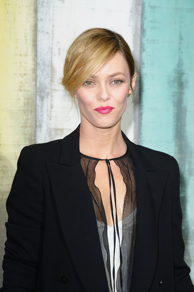 Vanessa Paradis styled her hair in a chignon with sexy side-swept bangs for the Chanel fashion show.
