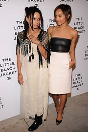 Lisa Bonet went for a vintage look during Chanel's Little Black Jacket event with a white lace shift dress worn with a fringed shawl.