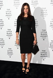 Julia Restoin-Roitfeld finished off her all-black outfit with a pair of ankle-strap peep-toes.