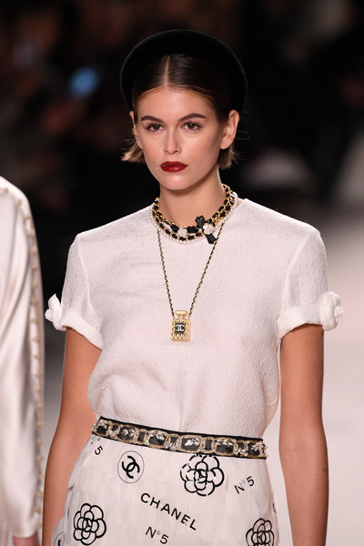 Kaia Gerber wore a chic perfume bottle necklace while walking the Chanel runway.