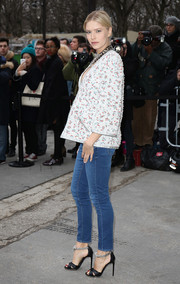 Elena Perminova styled her jeans with an elegant tweed jacket for a chicer finish.