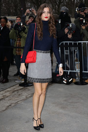Alma Jodorowsky chose a simple navy turtleneck to pair with her skirt.