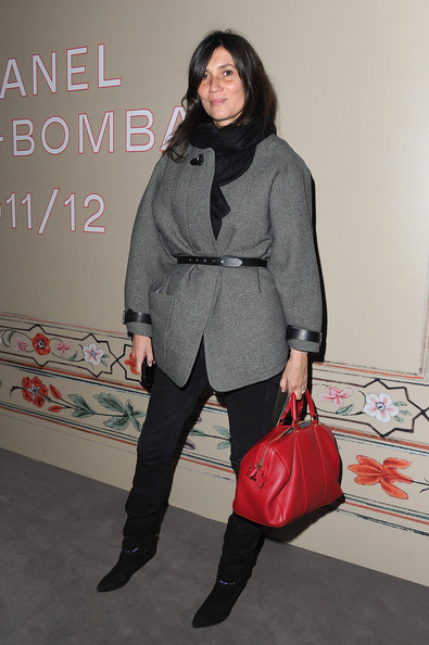 Emmanuelle Alt bundled up in a gray wool coat with contrasting leather straps at the Chanel show.